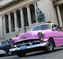 Picture of an old pink car.
