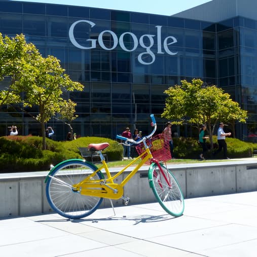 a colorful bicycle parked outside Google office