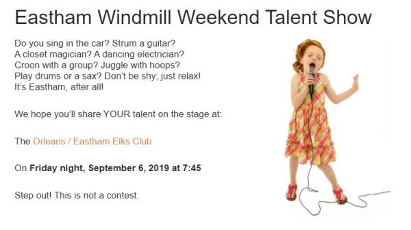 Screenshot from Eastham Windmill Weekend website with little girl singing into microphone